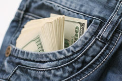 Dollar i facket av jeans Fotografering för Bildbyråer