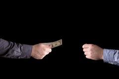 Dollar i hand på en svart bakgrund Arkivbilder