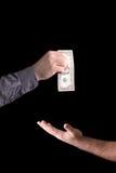 Dollar i hand på en svart bakgrund Royaltyfri Fotografi