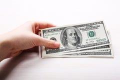Dollar i handen, slut upp Royaltyfri Bild