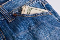 Dollar i jeans Arkivbild