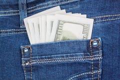 Dollar i jeansfack Fotografering för Bildbyråer