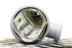 Dollar i rör för en plast- på en vit Royaltyfria Bilder