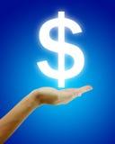 Dollar im Handkonzept Stockfotografie