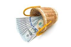 Dollar im Korb lokalisiert auf weißem Hintergrund Stockbilder