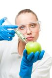Dollar injection into green apple Stock Photos