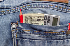 Dollar jeans pencil Royalty Free Stock Photography