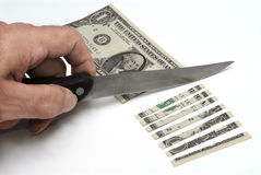 US One Dollar bill cut with knife, sliced, decline in value Stock Image