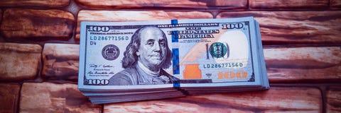 Dollar l?sen Wechsel auf einem Ziegelsteinhintergrund ein lizenzfreies stockfoto