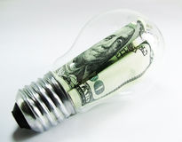 Dollar lamp. Metaphore of ideas for saving money. Or use less light and save money. Multi-concept for saving money Royalty Free Stock Image