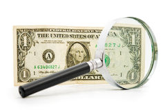 Dollar a magnifier Stock Photos