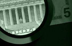 Dollar and magnifier Stock Photography