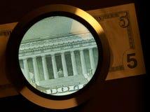 Dollar and magnifier Stock Photos