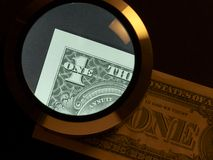 Dollar and magnifier Stock Image