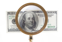 Dollar and magnifying lens Royalty Free Stock Images