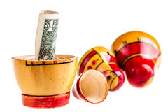 Dollar within Matryoshka doll Royalty Free Stock Images