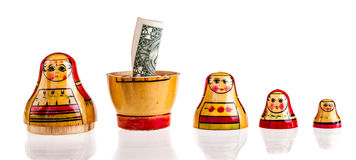 Dollar within Matryoshka Stock Photography