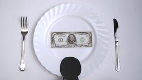 Dollar med oljasås för matställe lager videofilmer