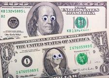 Dollar met grote ogen Stock Foto's