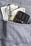 Dollar met telefoon in zak Royalty-vrije Stock Foto's