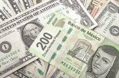 Dollar and Mexican Pesos Bills Stock Photos