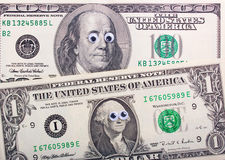 Dollar mit großen Augen Stockfotos