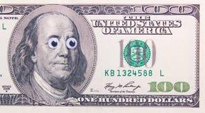 Dollar mit großen Augen Lizenzfreies Stockbild