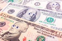 Dollar mit großen Augen Stockbilder