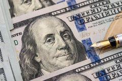 Dollar mit Stift Stockfotos