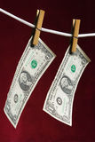 Dollar mit zwei Amerikanern Stockfotos
