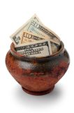 Dollar money. Dollar paper money in clay pot, on white background Royalty Free Stock Photography