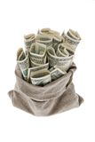 Dollar money bills into a bag Stock Image