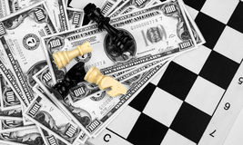 Dollar Money and Chess Stock Image