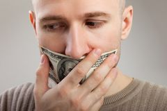 Dollar money gag shut voiceless men. Human silence - dollar currency gag shut men mouth Stock Photography