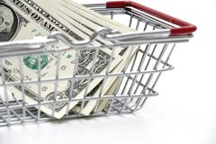 Dollar money with Shopping Cart On White Background Shot In Stud royalty free stock images