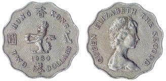 2 dollar mynt som 1980 isoleras på vit bakgrund, Hong Kong Royaltyfria Foton
