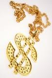 Dollar necklace. Golden dollar symbol necklace close-up Stock Photos