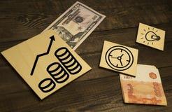 100 dollar nota's met grafiek als achtergrond stock fotografie