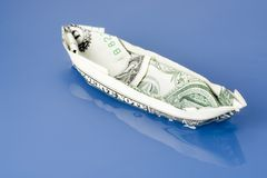 Dollar note paper boat Royalty Free Stock Photos