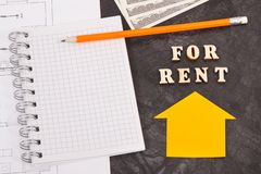 Dollar, notepad for notes and electrical diagrams, renting house or flat concept stock photos