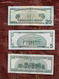 Dollar notes. American dollar notes on wooden background stock photography