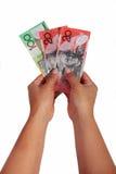 Dollar notes against white background. Girl holding dollar notes against white background Stock Photos