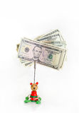 Dollar notes in baby cradle for notes. Royalty Free Stock Images