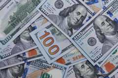 Dollar notes background including the new blue notes Royalty Free Stock Photos