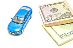 Dollar notes and blue car on white Stock Images