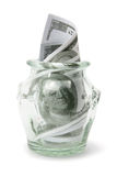Dollar Notes in Bottle. On White Background Royalty Free Stock Photography