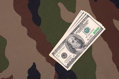 Dollars on a camouflage background Royalty Free Stock Image