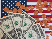 Dollar notes and coins and flag of the United States Stock Photography