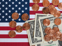 Dollar notes and coins and flag of the United States Stock Image