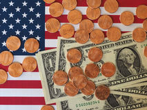 Dollar notes and coins and flag of the United States Stock Photo
